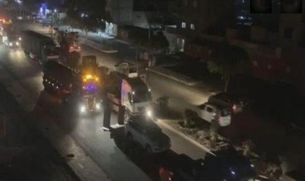 خبرنگاران 50 کامیون حامل تجهیزات نظامی آمریکا وارد خاک سوریه شد